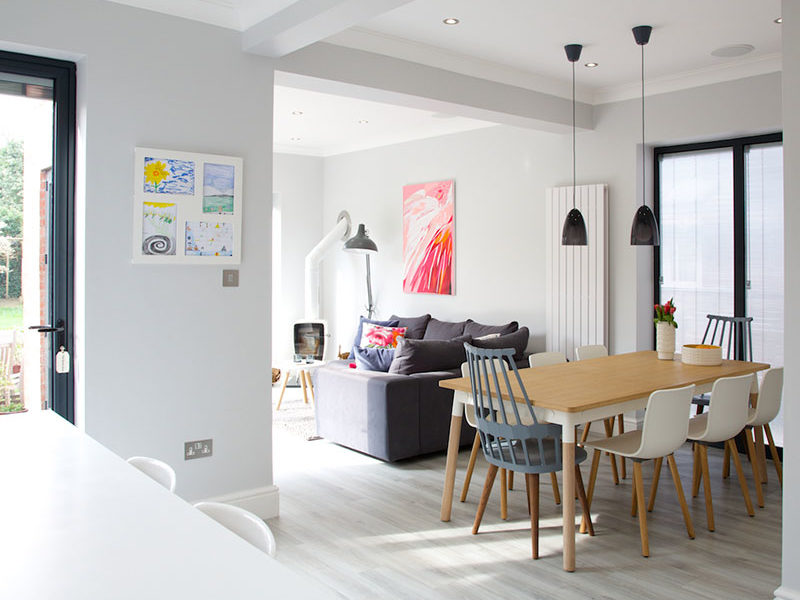 White kitchen and Family Room with colourful artwork