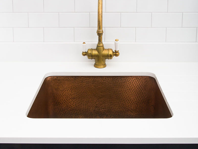 hammered copper sink and brass tap