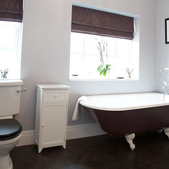 classic period bathroom with roll top bath