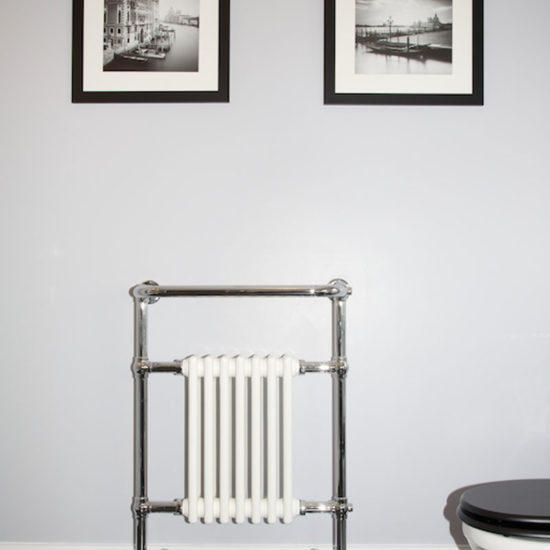 traditional style bathroom radiator with pictures above