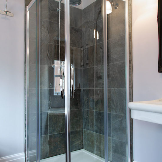 shower unit with green honed slate wall tiles
