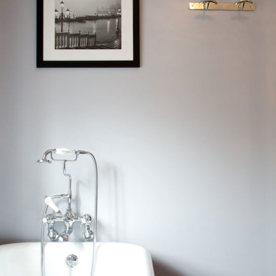 classic telephone style bath taps and silver wall hooks