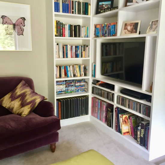 built in bookcase and TV storage