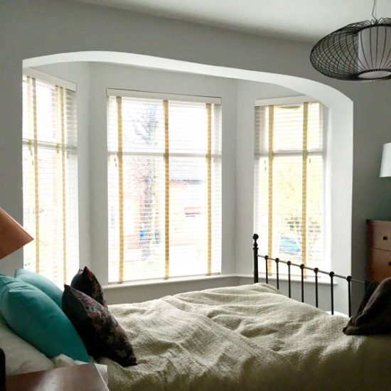 wrought iron bed and wire pendant light