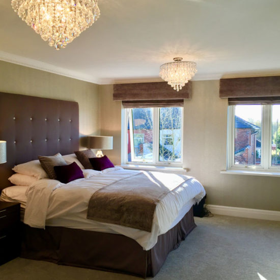 smart upholstered bed and chandeliers