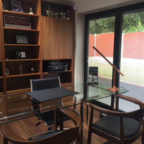 walnut shelving and glass dining table