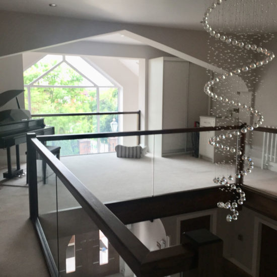 statement chandelier over double height staircase