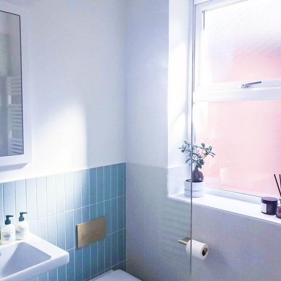 light and bright shower room with back to wall WC