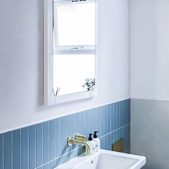 vertical blue wall tiles in bathroom