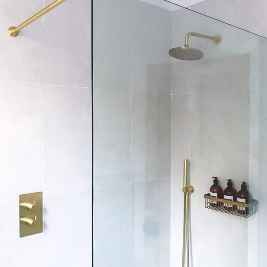 shower screen with brass handheld shower and fittings