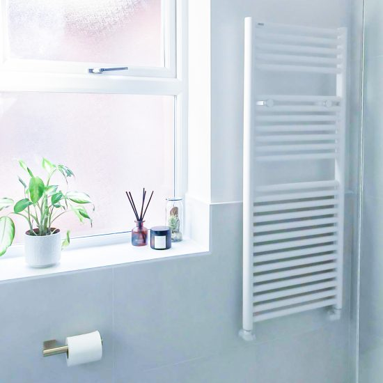 Tissino heated towel rail with large format cement wall tiles