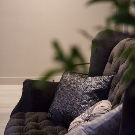 charcoal velvet buttoned sofa in photography studio