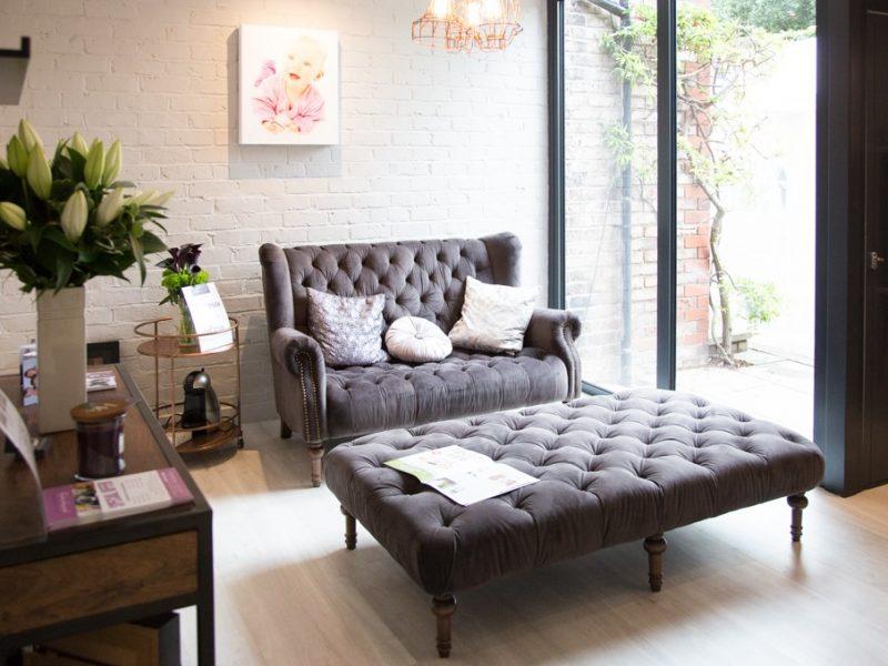 photography studio waiting area upholstered velvet sofa