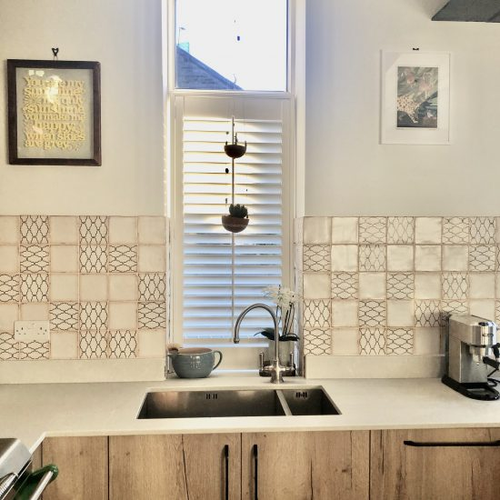 patterned vintage wall tiles by sink