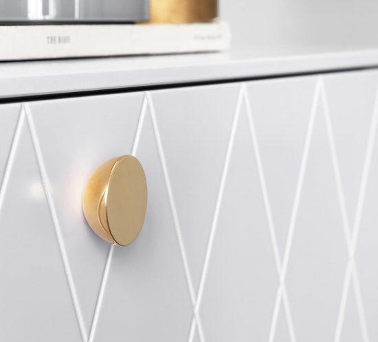 white cabinet with brass knob handle